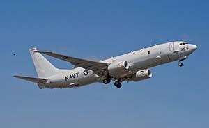 国防部:美军舰机对华高频度抵近侦察是引发海空意外根源