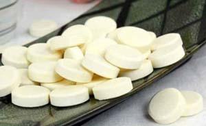 广东警方缴获含三聚氰胺酸奶片糖25吨,涉全国12省市区