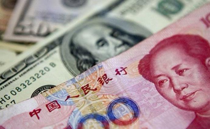 在岸、离岸人民币对美元汇率分别跌破6.90和6.91