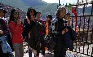 中国西藏网:杨幂七夕拜佛无意中打了外媒和达赖的脸