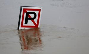 侠客岛:关于洪水的争论,不要变成一地鸡毛