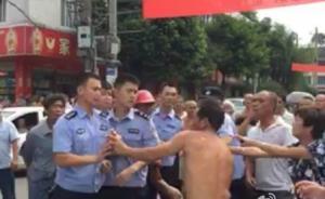 """阻挠执法、辱骂抓扯还高呼""""警察打人"""",四川彭州2人被刑拘"""