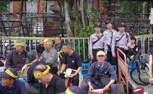 媒体关注老兵包围台立法机构:他们是台湾的建设者